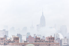 Misty New York City Manhattan skyline with Empire State Building. Royalty Free Stock Images