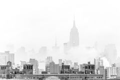 Misty New York City Manhattan skyline with Empire State Building. Royalty Free Stock Image