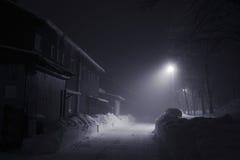 Misty night. Winter foggy misty night with lamp light Royalty Free Stock Image