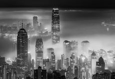 Misty night city. Misty night view of Victoria harbor in Hong Kong city royalty free stock photo