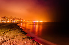 Misty Night Skyline Of City On The Seaside Stock Photography