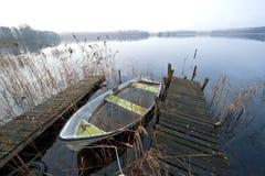 Misty november morning at lake. Abandoned boat at lake an misty november morning Royalty Free Stock Photos