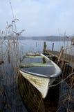 Misty november morning at lake. Abandoned boat at lake an misty november morning Royalty Free Stock Photo