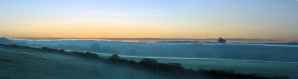 Misty October morning. A misty October morning panoramic over English fields in Derbyshire Stock Photo