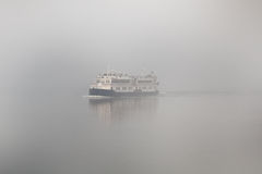 Misty passenger boat Royalty Free Stock Images