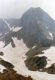 Misty peak. Judele and frozen lake Stock Photo