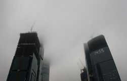 Misty prospects of business industries. Construction works under the fog Stock Photo