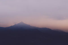 Misty Purple Mountians. Purple mountains on a hazy evening with fog Stock Photography