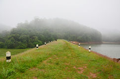 Misty and raining in Morning at A large reservoir in Pang Ung Stock Image
