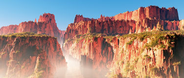 Misty red rocks canyon landscape with river and blue sky. Panoramic shot stock image