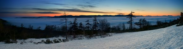 The misty river. Panorama hidden valley fog at sunset, made from the slope of the mountain Royalty Free Stock Photo