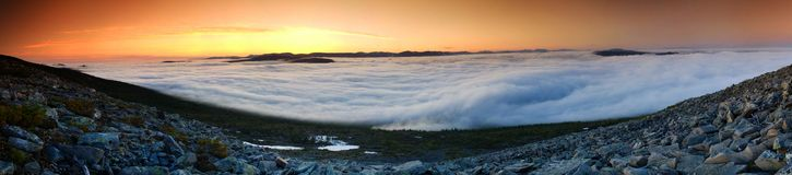 The misty river. Panorama hidden valley fog at sunset, made from the slope of the mountain Stock Images