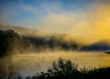 Misty river at dawn. Scenic landscape near forest stock photo
