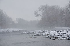 Misty River after a Fresh Snowfall Royalty Free Stock Image