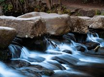 Misty River Waterfall in Park stock photo