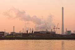Misty riverside with industrial pollution Royalty Free Stock Photo