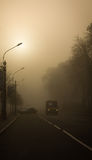 Misty road. The city wakes up. View from the city center of Chernigov. Ukraine Royalty Free Stock Photography