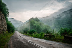 Misty road in High Mara. Misty road in Caucasus mountains Stock Photography