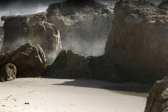 Misty Rocks. Landscape with large rocks, sand and mist behind Royalty Free Stock Images