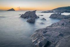 Misty Rocks en la puesta del sol Fotos de archivo libres de regalías