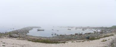 Misty rocky seashore Royalty Free Stock Image