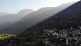 Misty scenerey small town under mountains stock footage