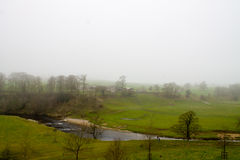 Misty Scenery in Wharfedale. Beautiful misty scenery and grey sky in Bolton Abbey, Wharfedale, North Yorkshire, UK Stock Images