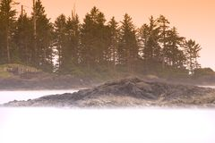 Misty Sea. Ocean swirling around an island Royalty Free Stock Images