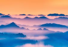 Misty silhouettes of mountains. Misty silhouettes of far mountains stock image