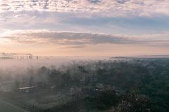 Misty spring morning on the outskirts of the city stock images