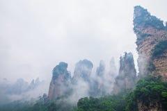 Misty steep mountain peaks - Zhangjiajie national park Royalty Free Stock Photos