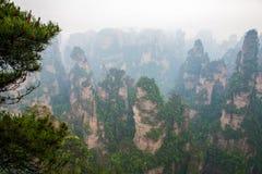 Misty steep mountain peaks - Zhangjiajie national park Stock Images