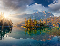 Misty summer morning on the Eibsee lake in German Alps. Stock Photo