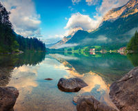 Misty summer morning on the Hintersee lake Stock Image
