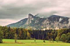 Misty summer mountain hills landscape. Filtered image:cross proc Royalty Free Stock Image