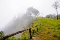 Misty on summit. Passage in the mist on the summit Royalty Free Stock Image