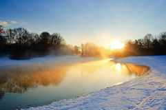 Winter sunrise scene. Winter cold sunrise lake scene in Ostpark, Munich Royalty Free Stock Images