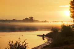 Misty sunrise. Fog on the water. Nature background Stock Image
