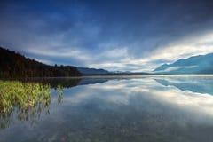 Misty sunrise on alpine lake Barmsee Royalty Free Stock Images