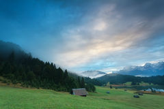 Misty sunrise at alpine lake Geroldsee Stock Images