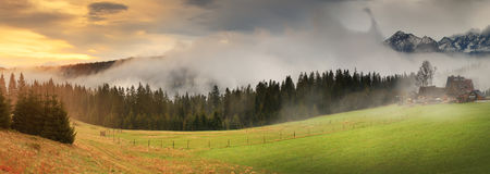 Misty sunrise in Alps Stock Photography