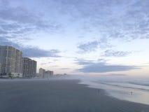 Misty Sunrise on Daytona Beach in Florida. Stock Photos