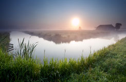 Misty sunrise on Dutch farmland Royalty Free Stock Photos