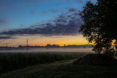 Misty sunrise the field. Misty Morning in Latvia, Balvi Royalty Free Stock Photo