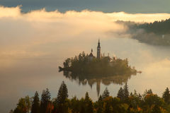 Misty sunrise on the lake Bled in autumn Stock Photo