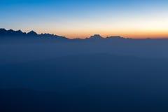 Misty sunrise mountain landscape with stunning. Royalty Free Stock Photo