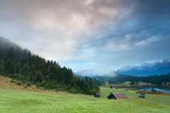 Misty sunrise over alpine meadows by Geroldsee lake Royalty Free Stock Photos