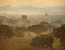 Misty sunrise over ancient architecture of old Buddhist Temples Royalty Free Stock Photos