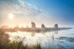 Misty sunrise over bog. Misty sunrise over water in bog, Fochteloerveen, Netherlands royalty free stock photos