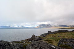 Misty sunrise over the hills of the eastern fjords in Iceland royalty free stock photos